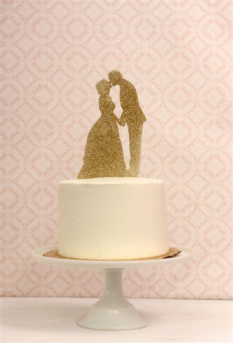 gold wedding cake decorations silhouette wedding cake topper in gold glitter