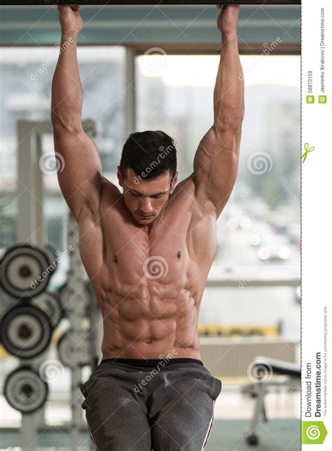 performing hanging leg raises abs exercise stock image image 58870159