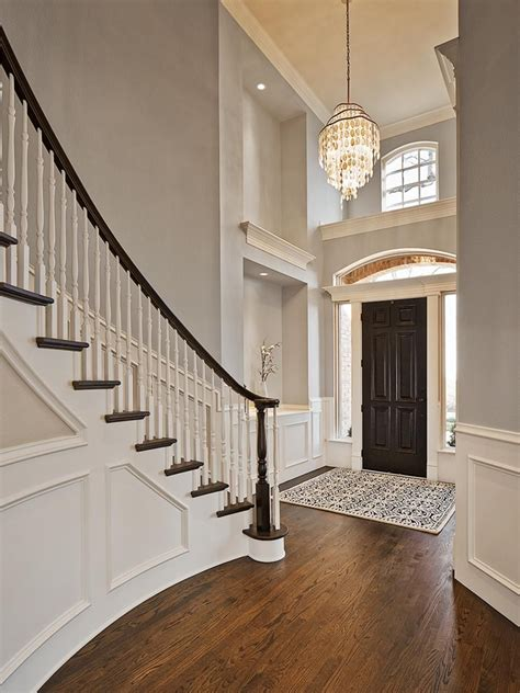 light grey walls this stunning foyer features light gray walls paired with