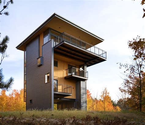 Storey tall house reaches above the forest to see the lake modern