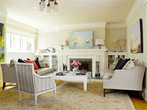 light yellow paint living room glass front cabinets transitional living room