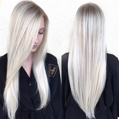 hairstylist tips about layers women s sleek platinum blonde hair with side part and v