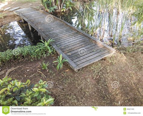small wooden bridge small wooden bridge over a pond stock photo image 45627493