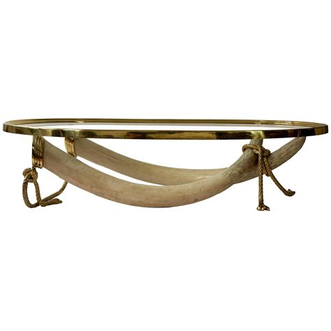 elephant tusk coffee table large glass and brass elephant tusk base coffee table by