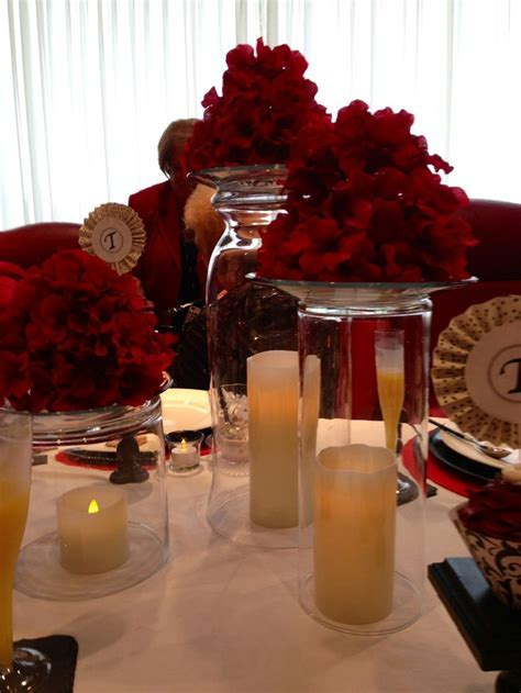 Easy centerpiece idea    upside down cylinders/vases
