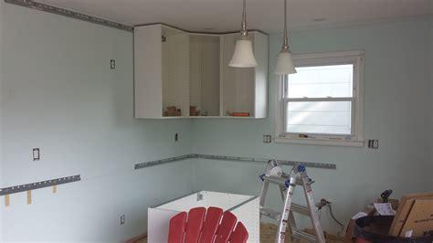 ikea corner wall cabinet installation 187 cabinet installation round 2 hanging ikea cabinets