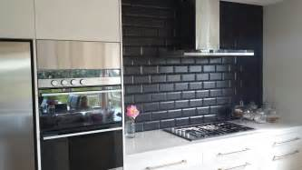 black subway tile kitchen backsplash of subway tile