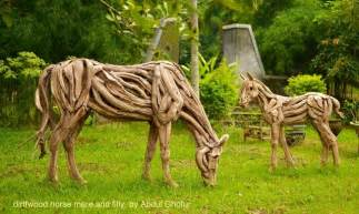 Driftwood sculptures traditional garden statues and yard art