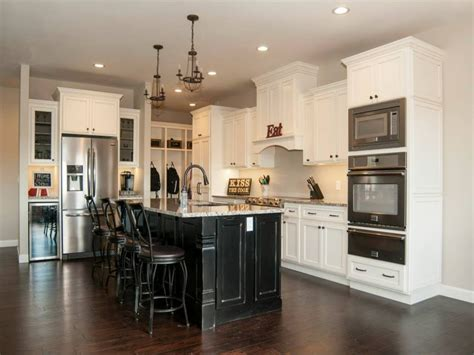 white kitchen with black island stacked moulding glazed kitchen cabinets white