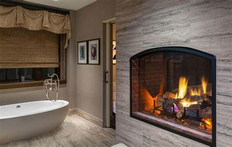 couples treatment suite with see thru fireplace at the