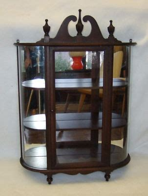 vintage small wall hanging curio cabinet curved glass
