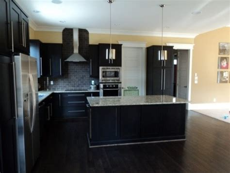 dark kitchen cabinets with dark hardwood floors contemporary kitchen espresso cabinets dark floor and