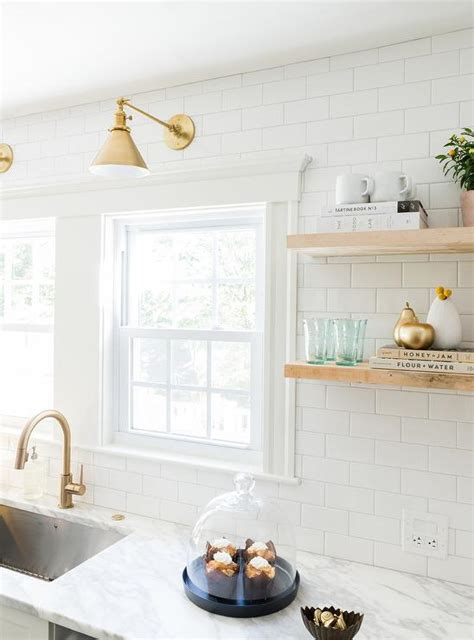 white shaker cabinets gold pulls design ideas white and gold kitchen features white shaker cabinets