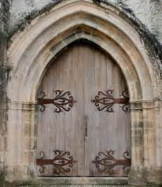 style castle door with decorative wrought iron