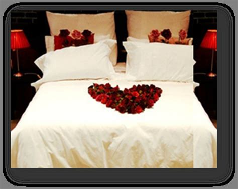 u in bed arrange rose petals on bed to spell out quot i love you quot to
