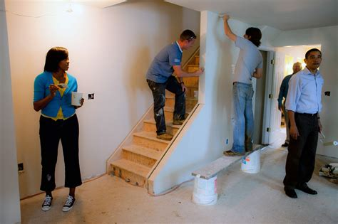 what does a house painter do file michelle and barack obama paint at a habitat for