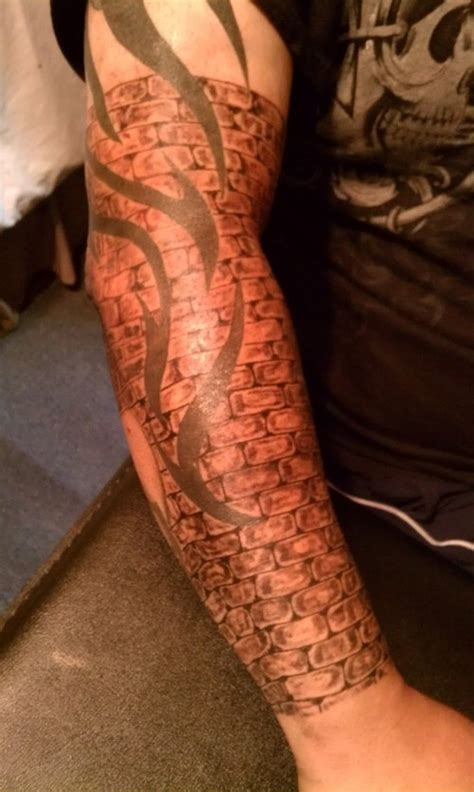 tribal and brick wall tattoo on bicep tattooshunt com