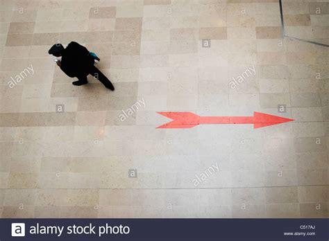 Opposite Of Floor Walking Opposite Direction Of Arrow Sign On Floor