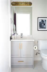 gray bathroom vanity with gold pulls transitional