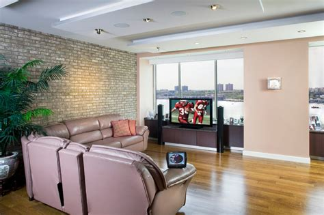 living room electronics city space with exposed brick modern living room new york by electronics design inc
