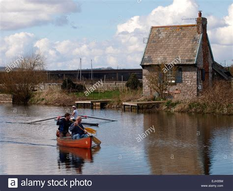 Topsham Lock Cottage by Boating On The Exeter Canal Near The Topsham Ferry Point