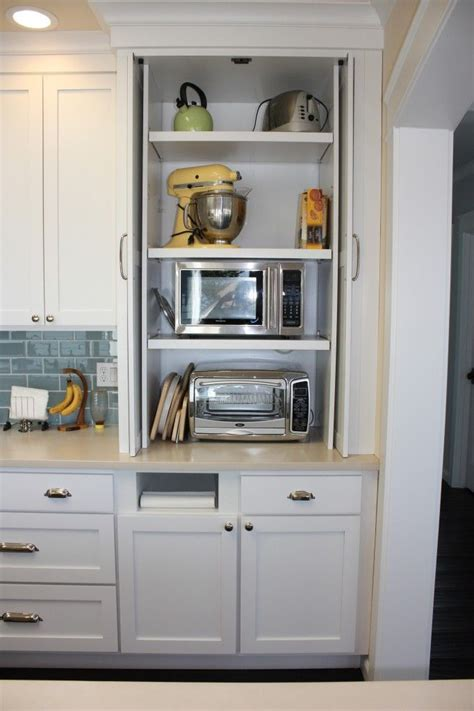 kitchen appliance cabinet storage hidden microwave and toaster oven kitchen ideas pinterest appliance garage toaster and towels