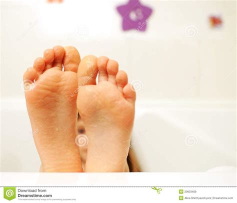 feet in bathtub little girl feet covered with water in the bathtub royalty