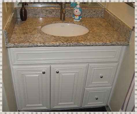 kz kitchen cabinet installed 36 quot vanity with ivory maple cabinet and tigerskin granite top yelp