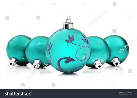 bright turquoise blue christmas baubles on stock photo
