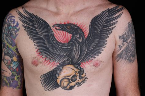 raven chest tattoo chest