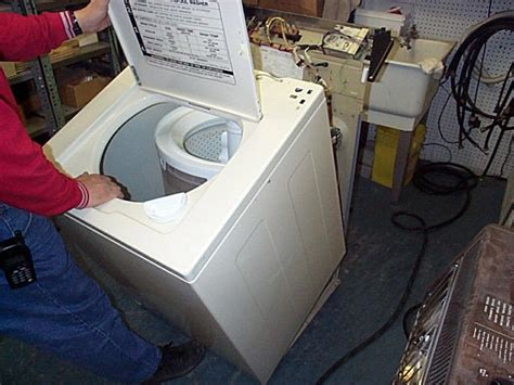whirlpool washer cabinet removal kenmore 400 top load washer drum knocking against the