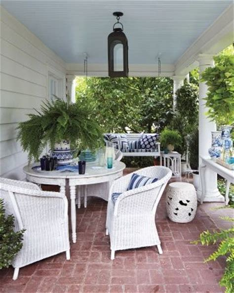 room service brick patio wicker porch furniture blue accent pillows landscape martha