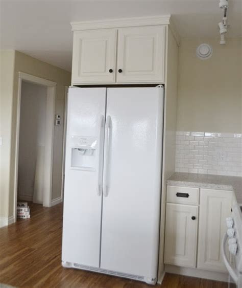 over the refrigerator cabinet boxing in fridge with cabinetry momplex vanilla kitchen