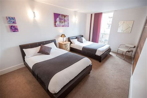 bedroom with 2 beds 2 bed triple apartments kspace serviced apartments sheffield