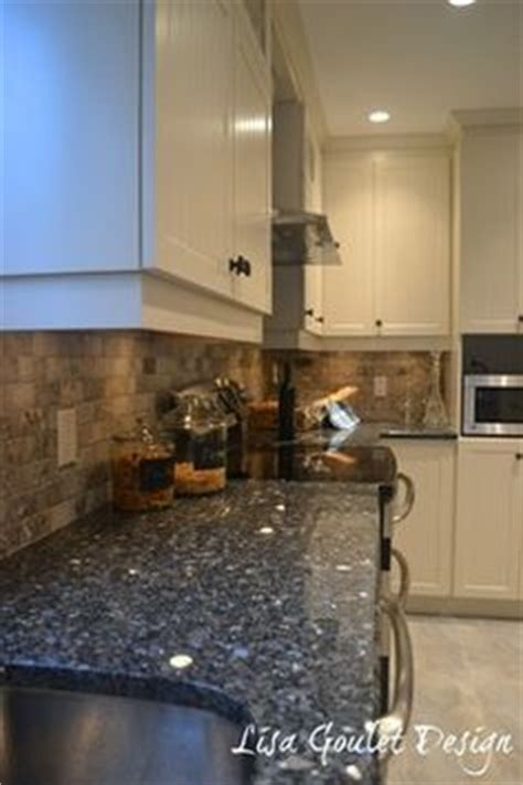Blue Pearl Granite Backsplash by Blue Pearl Granite Countertop And Tumbled Marble Backsplash