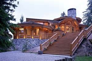 log stair railing for cool log home with round chimney