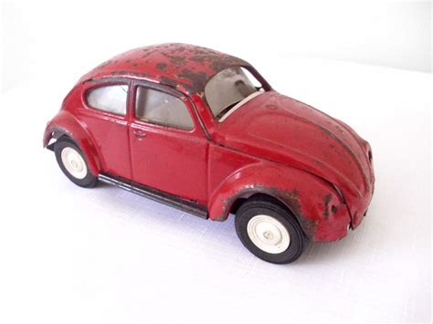 volkswagen red car 1960s 60s rusty red tonka vw bug volkswagon car toy hippie
