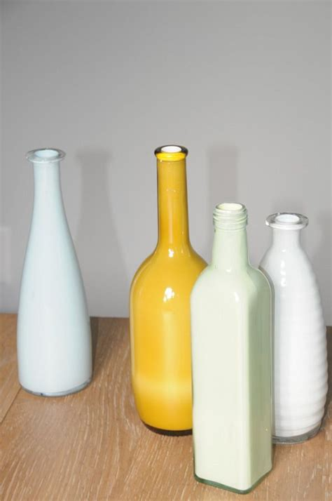 acrylic paint jugs inside painted bottles