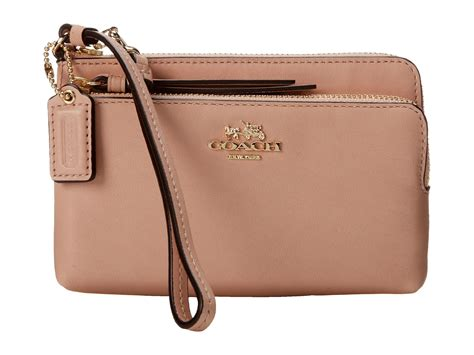 coach leather zip wristlet in pink lyst