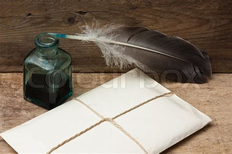 Fn A Quill letter and quill pen with ink on a wooden background stock photo colourbox