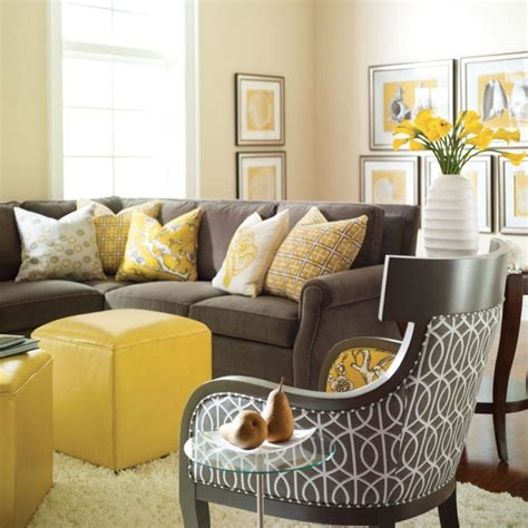 yellow sofa dark pillows dark rug grey cabinet and black black white and yellow living room ideas http