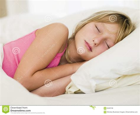girls laying in bed young girl lying in her bed royalty free stock photos image 6440748