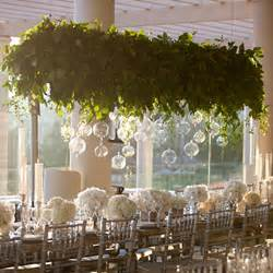 Suspended greenery arrangement with candels wedding style