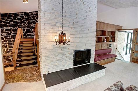 Mid Century Fireplace Design by Dramatic 1959 Split Level Time Capsule House In Same