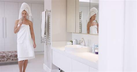 girl singing in bathroom beautiful woman singing in bathroom wearing white towel