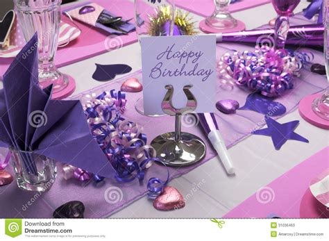 pink and purple birthday party table setting stock image