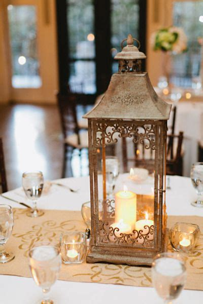 gold lantern centerpieces wedding at the mansion at judges hill by demarco photography lantern