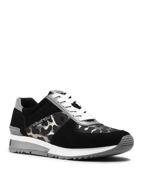 black michael kors sneakers michael michael kors wrap trainer sneakers in black