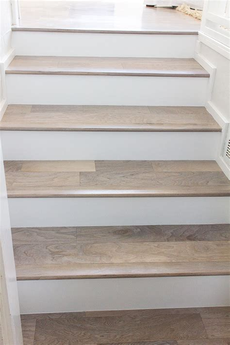 wood plank tile on staircase with white painted railings ideas we have new stair railing jenna sue design blog