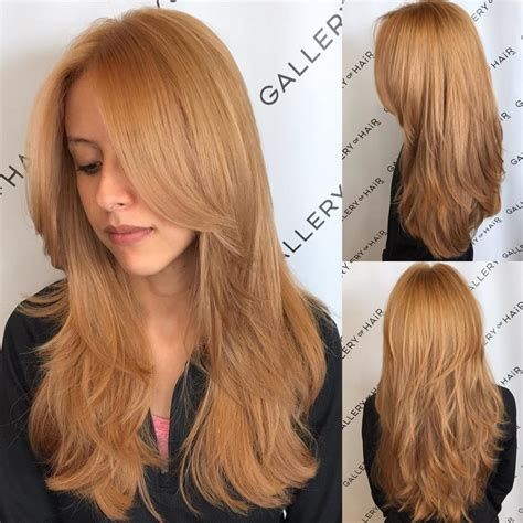 cut off long blonde hair women s golden strawberry blonde shaggy layered cut with